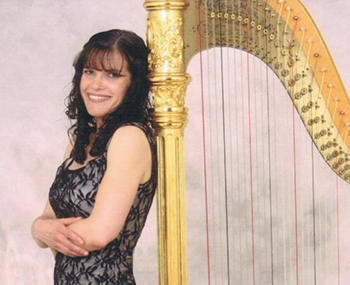 Photo of Pamela Brown with her harp who has provided elegant music for over 20 years.